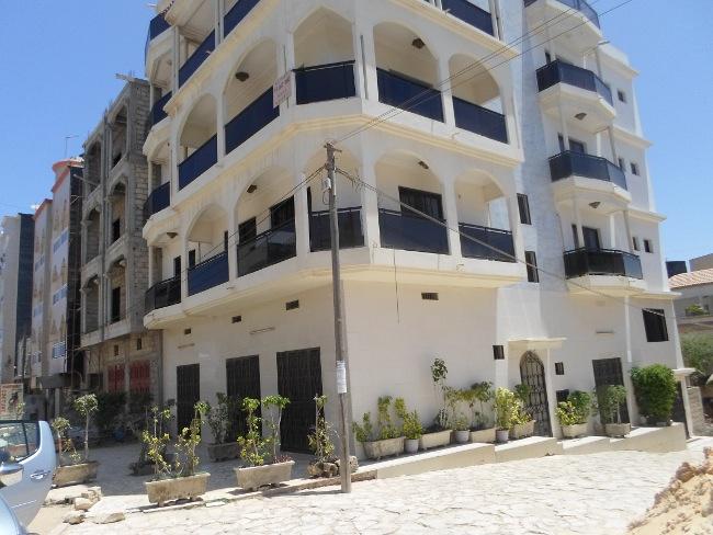 A louer immeuble r 3 pour usage bureau for Plan maison 150m2 senegal